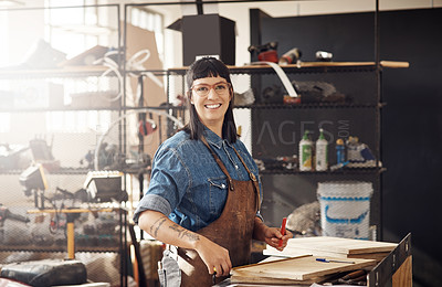 Buy stock photo Cropped portrait of an attractive young woman working in her creative workshop