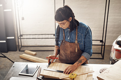 Buy stock photo Cropped shot of an attractive young woman working in her creative workshop