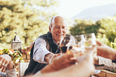 Buy stock photo Cropped shot of people sharing a toast while having dinner together