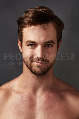 Buy stock photo Cropped portrait of a handsome young man against a grey background