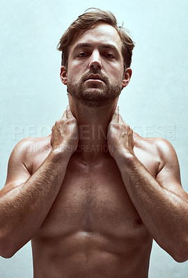 Buy stock photo Shot of a handsome bare-chested young man posing in the studio