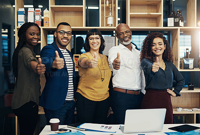 Buy stock photo Portrait of a group of creative businesspeople showing thumbs up
