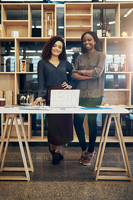 Buy stock photo Portrait of two designers standing together in a modern office