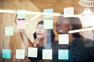 Buy stock photo Cropped shot of two designers having a brainstorming session
