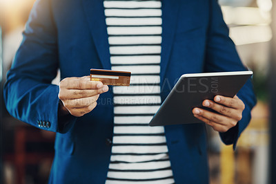 Buy stock photo Cropped shot of an unrecognizable businessman using his credit card online