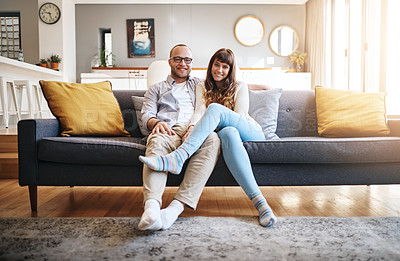 Buy stock photo Portrait of a happy young couple relaxing on the sofa at home