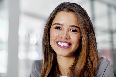 Buy stock photo Cropped portrait of a confident young businesswoman in an office