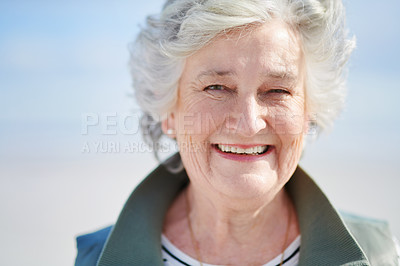 Buy stock photo Portrait of a senior woman enjoying a day at the beach