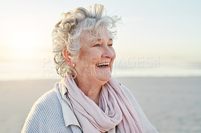 Buy stock photo Shot of a senior woman enjoying a day at the beach