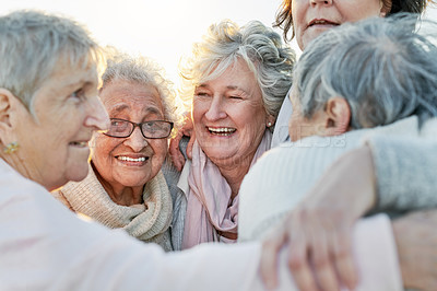 Buy stock photo Shot of a group of happy senior women bonding at the beach