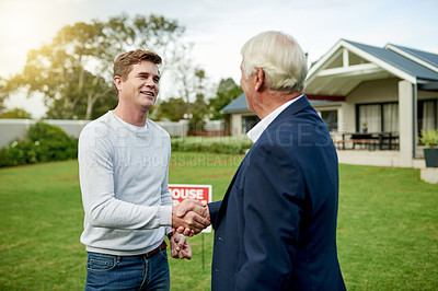 Buy stock photo Shot of a home owner shaking hands with his real estate agent