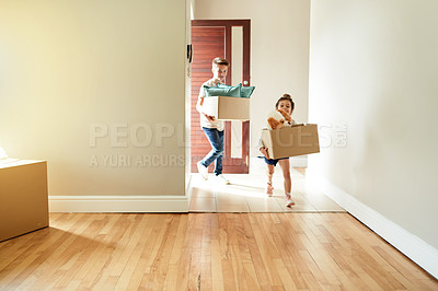 Buy stock photo Shot of a little girl and her brother carrying boxes into their new home