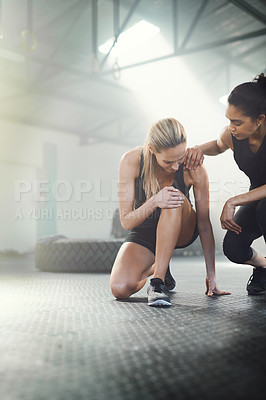 Buy stock photo Shot of a sporty young woman suffering from a sport's injury