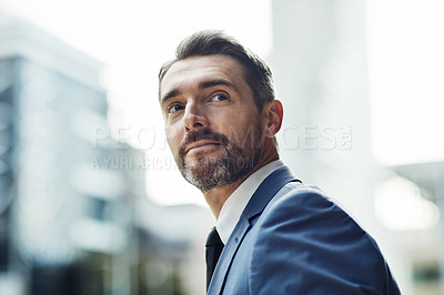 Buy stock photo Cropped shot of a handsome mature businessman on his way in to work