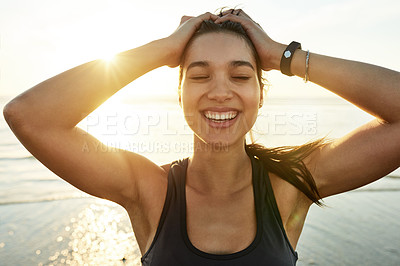 Buy stock photo Cropped shot of an attractive and athletic young woman working out on the beach