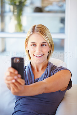 Buy stock photo Attractive young woman taking picture of herself with camera phone