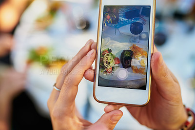 Buy stock photo Cropped shot of a woman taking a picture of her meal on a smartphone