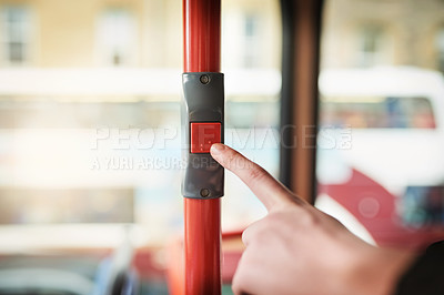Buy stock photo Cropped shot of a woman pressing the stop button while traveling on a bus