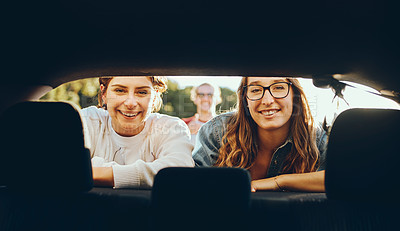Buy stock photo Cropped portrait of two attractive young women enjoying a roadtrip