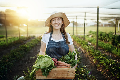 Buy stock photo Cropped shot of an attractive young woman working on her self owned farm
