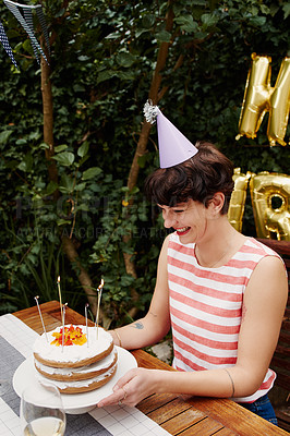 Buy stock photo Cropped shot of an attractive young woman celebrating her birthday outdoors