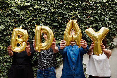 Buy stock photo Cropped shot of a group of friends holding up ballon letters reading