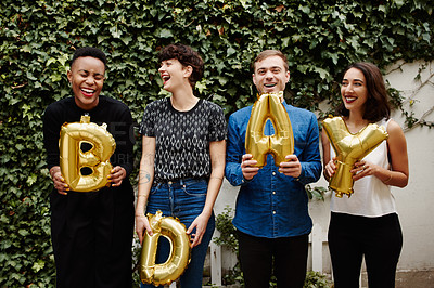Buy stock photo Cropped portrait of a group of friends holding up ballon letters reading