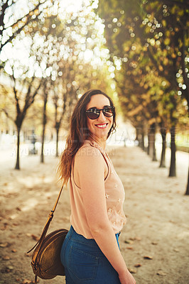 Buy stock photo Cropped portrait of an attractive young woman exploring the city of Paris in France