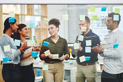 Buy stock photo Shot of a group of businesspeople applauding a colleague in an office