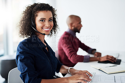 Buy stock photo Cropped portrait of an attractive young female call center agent working in her office