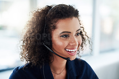 Buy stock photo High angle shot of an attractive young female call center agent working in her office