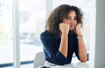 Buy stock photo Cropped shot of an attractive young businesswoman looking bored while working at her desk in the office