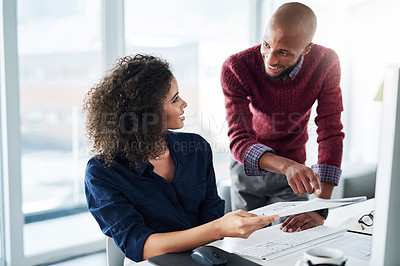 Buy stock photo Cropped shot of a male supervisor helping an attractive young businesswoman while working in their office