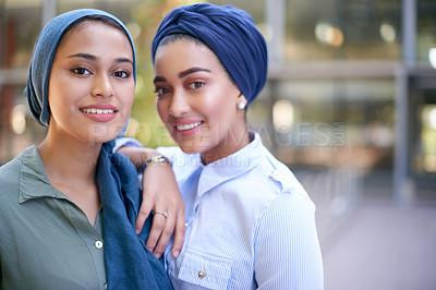 Buy stock photo Portrait of two beautiful young female students outside on campus