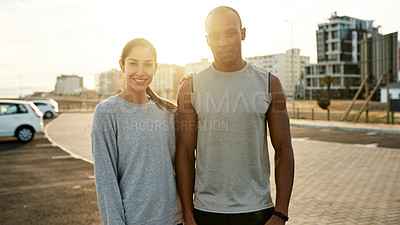 Buy stock photo Portrait of a sporty young man and woman standing together outdoors