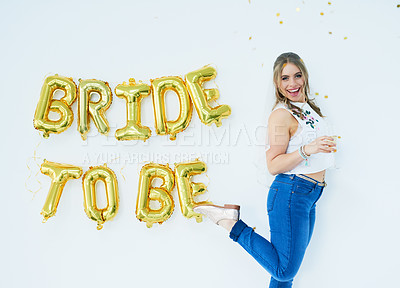"Buy stock photo Studio portrait of a happy young woman celebrating her engagement with ""bride to be"" in balloons on the wall"