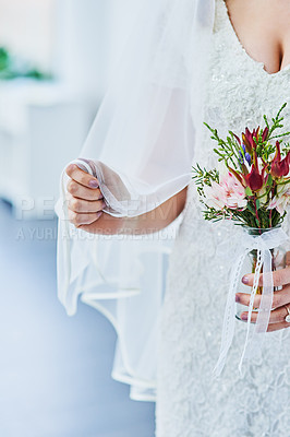 Buy stock photo Cropped shot of a beautiful young bride holding a bunch of flowers on her wedding day