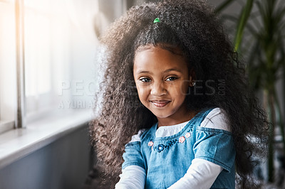 Buy stock photo Portrait of an adorable little girl relaxing at home