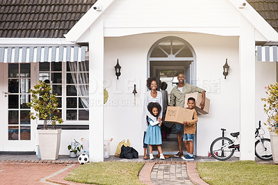 Buy stock photo Portrait of a happy family standing in front of their new home