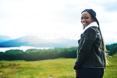 Buy stock photo Cropped shot of a young woman exploring the outdoors