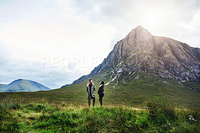 Buy stock photo Shot of a loving young couple out exploring nature