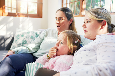 Buy stock photo Shot of a family watching television together at home