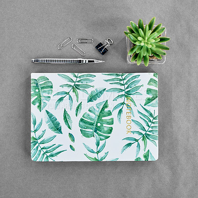 Buy stock photo Shot of a notebook on a work desk in a modern office