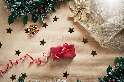 Buy stock photo Shot of a Christmas gift wrapped in red wrapping paper