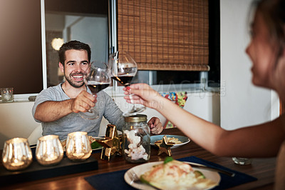 Buy stock photo Cropped shot of people toasting at a dinner party