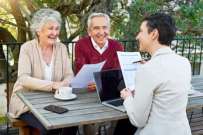 Buy stock photo Cropped shot of a senior couple meeting with their financial planner outside