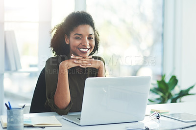 Buy stock photo Portrait of a confident young businesswoman sitting at her desk in a modern office