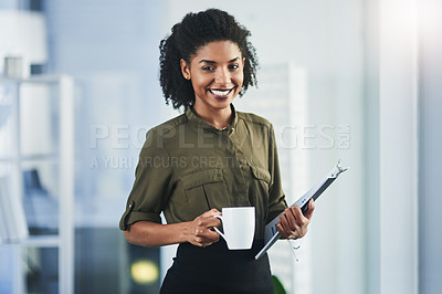 Buy stock photo Portrait of a young businesswoman holding a cup of coffee and a digital tablet in her office