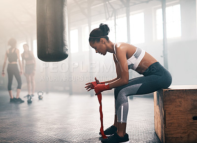 Buy stock photo Shot of an attractive and athletic young woman working out in the gym