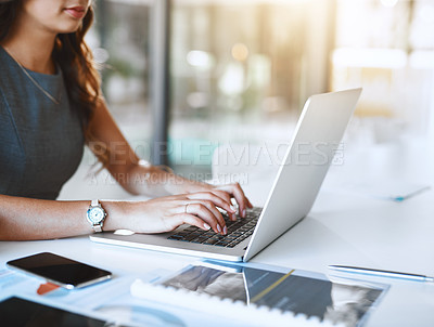 Buy stock photo Cropped shot of an unrecognizable young businesswoman working in her office